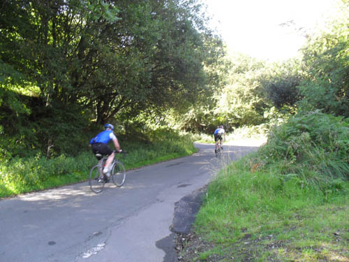 Cyclists struggle towards the first of the steep corners