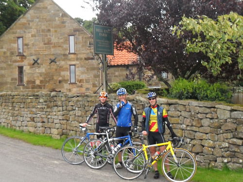 Ian, Dave and Paul (left to right) posing for a picture outside the legendary Bell End Farm just before the gradient increases. Rob chose to take the pic.