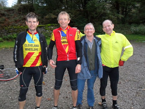 Back in Patterdale, Dave is on the left (complete with helmet hair), John P, John K and Mick on the right with me taking the photo.